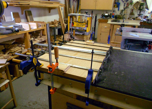 Clamped up top panel on support table.