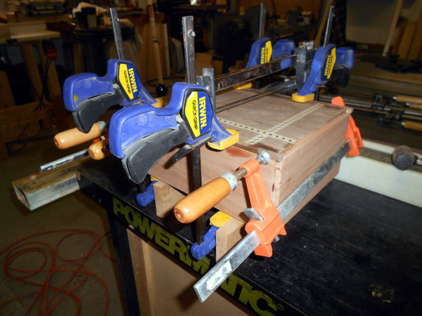 Clamping edge banding to rabbets on the box.