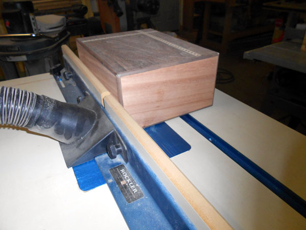 Rounding the edge banding on the router table.