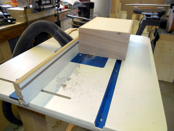Routing the inlay grooves in the box top.
