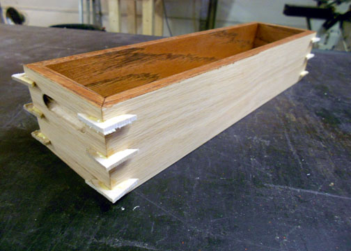 View of box with rough cut key pieces glued into place.
