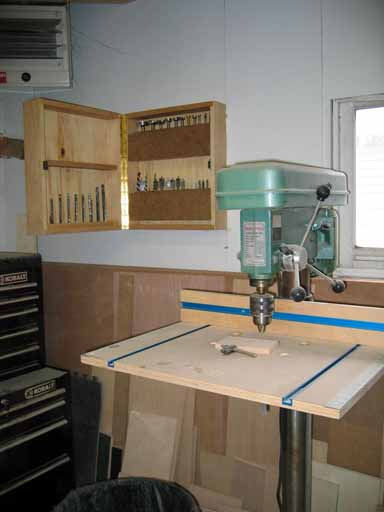 View of drill press and bit storage cabinet.