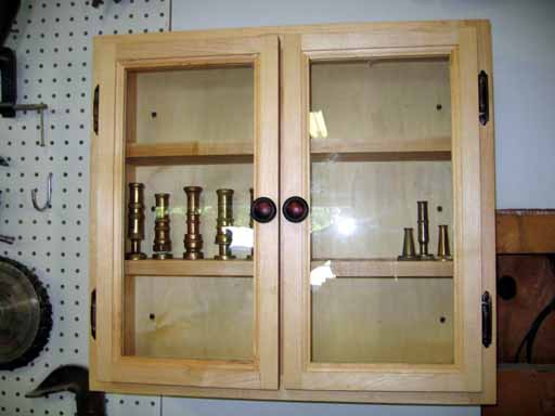 Finished Display Cabinet With Displayed Nozzles.