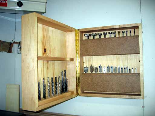 Finished drill cabinet showing holders in closed position