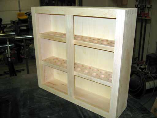 Finished display cabinet minus doors after applied finish.