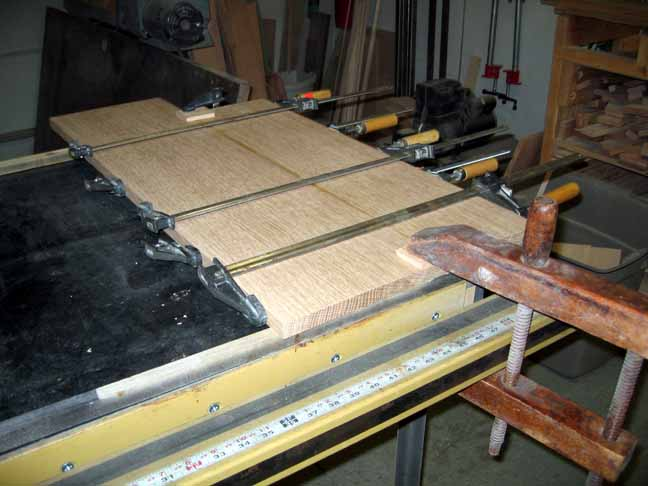 Shelf boards drying while being clamped.