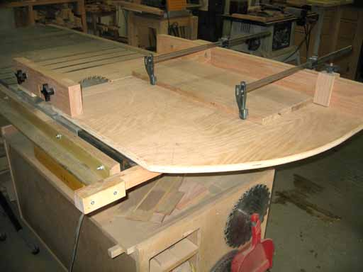 Upper unit shelves being cut to length with panel sled.