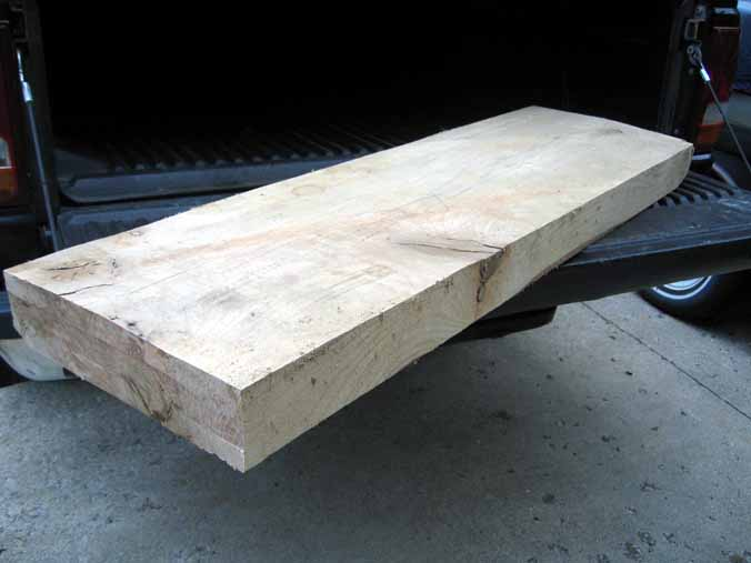 Oak plank laying flat in my pickup truck.