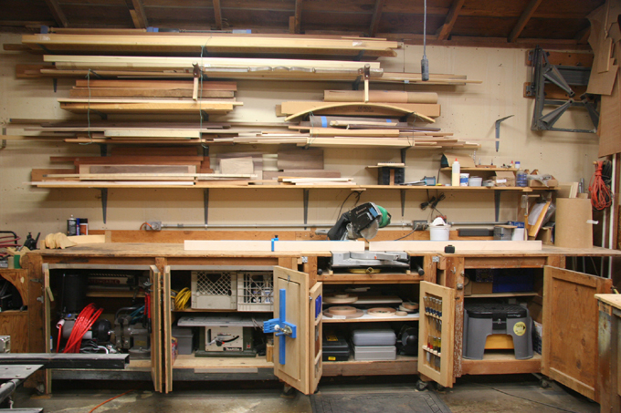 View of storage cabinet that is also used as a support for the miter saw.