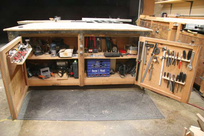 A view of the opened up work bench revealing some of Scott's tools.