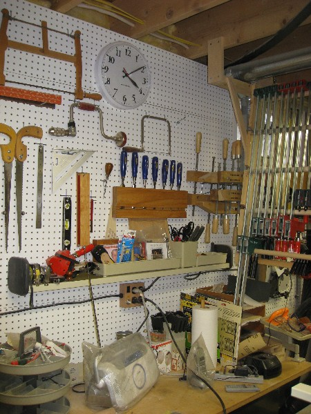 West wall view with woodworking hand tools.