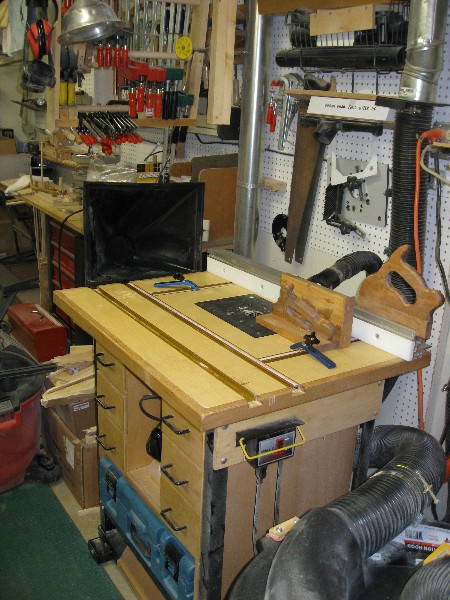 Shop built router table with full set of drawers.